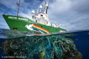 Debris from a fishing net seen underwater with MY Arctic Sunrise ship in background.  The crew of the Greenpeace ship MY Arctic Sunrise voyage into the Great Pacific Garbage Patch document plastics and other marine debris. The Great Pacific Garbage Patch is a soupy mix of plastics and microplastics, now twice the size of Texas, in the middle of the North Pacific Ocean.