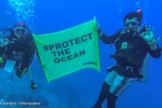 "An image captured from video shows two divers with banner reading  ""#Protect the Ocean"" during the Underwater Brand Audit for plastic waste in Pramuka island, Thousand Islands, north of Jakarta. About 30 divers join the activity to collect and classify the plastic waste found in the sea."